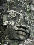 A Serene Likeness of Buddha Sculpted of Stone Peers from a Temple Wall Fotografisk tryk af Paul Chesley