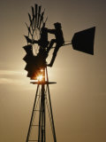 A Man Climbs a Windmill to Make Adjustments Photographic Print by Annie Griffiths Belt