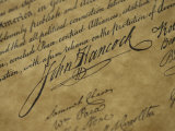 A Close View of John Hancocks Signature on a Reproduction of the Declaration of Independence Photographic Print by Todd Gipstein