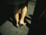Legs of a Walking Woman Wearing Stockings and Gray High Heeled Shoes Photographic Print by  xPacifica