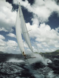 A Woman Aboard a Sailboat on a Rough Sea Photographic Print by Bill Curtsinger
