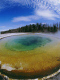 Elevated View of a Geyser at Yellowstone National Park Photographic Print by Paul Nicklen