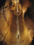 Cavers Cling to a Rope While Exploring the Cave Photographic Print by Stephen Alvarez