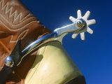 A Close-up of a Shiny Silver Spur on the Back of a Cowboy Boot Lámina fotográfica por Gipstein, Todd