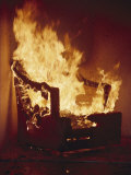 A Chair Set on Fire During a Flamability Test Photographic Print by Richard Nowitz