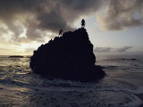 A Huge Rock in Waimea Bay is a Popular Climbing Spot Photographic Print by Chris Johns