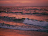 The Rising Sun Creates Beautiful Colors on the Waves Photographic Print by Bill Curtsinger