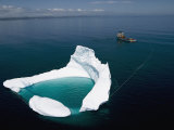 Towing an Iceberg Away from an Oil Platform Photographic Print by Randy Olson