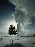 Old Faithful Geyser Erupting in Winter Photographic Print by Raymond Gehman