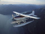 A Seaplane Takes a Sightseeing Tour over Misty Fjord Photographic Print by Bill Curtsinger
