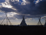 A Cluster of Teepees and Frames in a New Mexico Field Photographic Print by Raul Touzon