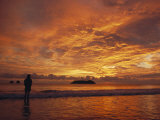 A Brilliant Orange Sunset on the Coast of Costa Rica Photographic Print by Tim Laman