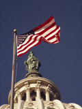 An American Flag and the Statue of Freedom Atop the Capitol Dome Photographic Print