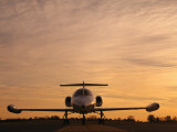 Twilight View of a Lear Jet on the Runway Photographie par Kenneth Garrett