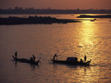 Boats Silhouetted on the Mekong River at Dusk, Phnom Penh, Cambodia Photographic Print by Steve Raymer