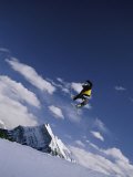Snowboarding at Mount Norquay in Alberta Photographic Print by Mark Cosslett