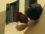 Three Umbrellas Hang Outside a Window Photographic Print by Raul Touzon
