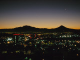 A Night View of Sprawling Mexico City and Nearby Mountains Photographic Print by Raul Touzon