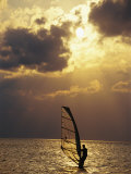 A Windsurfer Skims the Water, Silhouetted by Evening Sun on Pamlico Sound Photographic Print by Stephen St. John