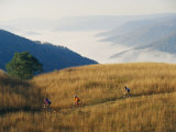 Mountain Bikers on Trail Above Fog-Covered Elk River Valley Photographic Print by Skip Brown