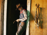 A Cowboy Braids a Lariat Photographic Print by Joel Sartore