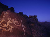 Ancient Rock Art Showing Kokopelli, the Flute Player, and a Shield Photographic Print by Ira Block