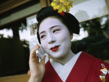 A Kimono-Clad Geisha Talks on a Cell Phone Photographic Print by  xPacifica