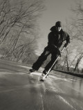 Ice Skater with a Hockey Stick on the Frozen C and O Canal Photographic Print by Skip Brown