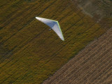 Hang-Glider Soars Over the Countryside Photographic Print by Skip Brown
