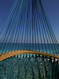The Turquoise Caribbean Sea Viewed Through Turquoise Hammock Strings Photographic Print by Raul Touzon