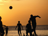 Soccer Game on Beach at Sunset, Zanzibar Town, Zanzibar Island, Zanzibar West, Tanzania Photographic Print by Lawrence Worcester