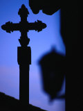 Cross and Lantern Silhouetted at Dusk, Rupit, Spain Photographic Print by Damien Simonis
