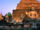 Serene Buddha and Ancient Ruins at Wat Mahathat, Sukhothai Historical Park, Sukhothai, Thailand Photographic Print by Anders Blomqvist