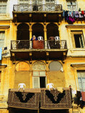 Persian Carpets and Washing Hanging on Apartment Balconies, Tripoli, Lebanon Photographic Print by Bethune Carmichael
