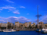 Boats Moored in Harbour with Buildings Behind, Barcelona, Spain Photographic Print by Anders Blomqvist