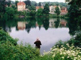 Man Fishing in Lake in In Oliwa, Gdansk, Poland Photographic Print by Rick Gerharter