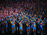Boys and Girls Dance in Formation During Arirang Mass Games, P'Yongyang, North Korea Photographic Print by Tony Wheeler