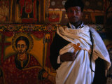 Priest Inside Ura Kida Nem Reth Church, Zeig Island, Lake Tana, Amhara, Ethiopia Photographic Print by Jane Sweeney