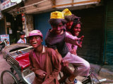Group on Rickshaw Celebrating Holi Festival, Delhi, India Photographic Print by Paul Beinssen