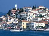 Waterfront and Town Behind Poros Harbour, Poros Town, Greece Fotografiskt tryck av Mark Daffey