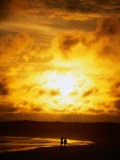 Couple in Silhouette on Beach Beneath Sunset, Isla Santa Cruz, Galapagos, Ecuador Photographic Print by Mark Newman