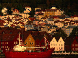 Fishing Vessel Moored in Front of Wooden Buildings on the Bryggen Waterfront, Bergen, Norway Photographic Print by Anders Blomqvist