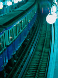 Train at Metro Station in Cite, Paris, France Photographic Print by Stephen Saks