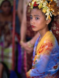 A Young Girl in Costume at the Usaba Sambah Celebration, Tenganan, Indonesia Photographic Print by Adams Gregory