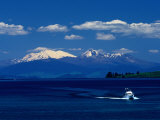 Boat Sailing with Mt. Ruapehu, Mt. Ngauruhoe and Mt. Tongariro in Background, New Zealand Photographic Print by Barnett Ross