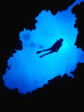 Diving off Limestone Platform into Blue Hole at Bat Cave, Gene&#39;s Bay, Bahamas Photographic Print by Michael Lawrence