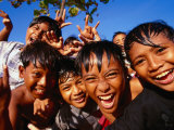 Exuberant Children, Nusa Dua, Bali, Indonesia Fotografie-Druck von Paul Kennedy