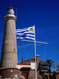 Uruguayan Flag Flying Before Faro (Lighthouse), Punta Del Este, Uruguay Photographic Print by Wayne Walton