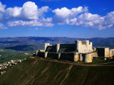Castle on Hilltop Overlooking Village, Crac Des Chevaliers, Syria Fotografiskt tryck av Mark Daffey