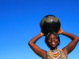 Zulu Woman Carrying Beer Pot, Zululand, South Africa Photographic Print by Ariadne Van Zandbergen